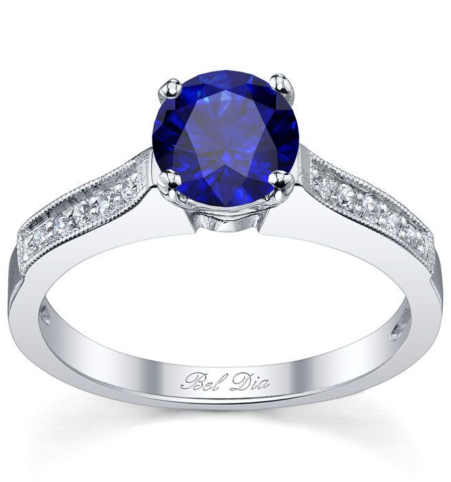 Exceedingly romantic with its unique contours and vintage milgrain accents,  this engagement ring is an emblem of the special love that you and your  partner ...