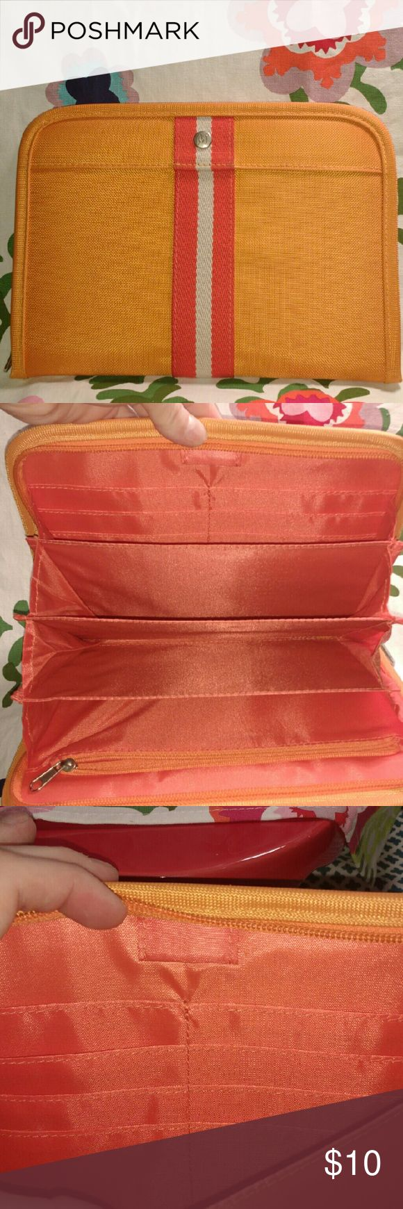 Orange Organizer Orange Filer with 4 pockets, 1 zipper pocket, 8 card holder pockets and a place to hold your pen. Bags