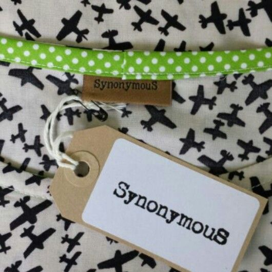 SynonymS label and swing tag, on one of our aeroplane printed tops, with lime green polka dot detail x