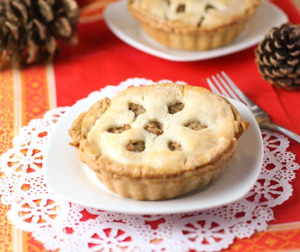 The Best Tourtière Recipe. (Canadian Meat Pie). Lightly spiced ground pork between flaky pastry. #meatpie, #tourtiere