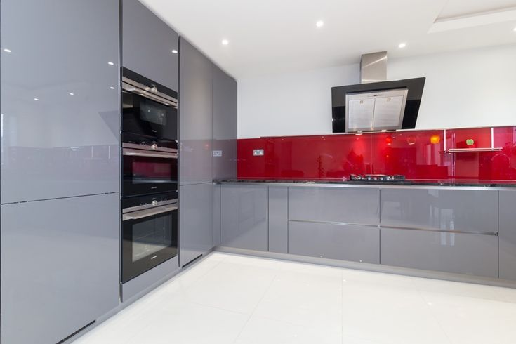 Grey handleless kitchen doors in a gloss lacquer kitchen finish.