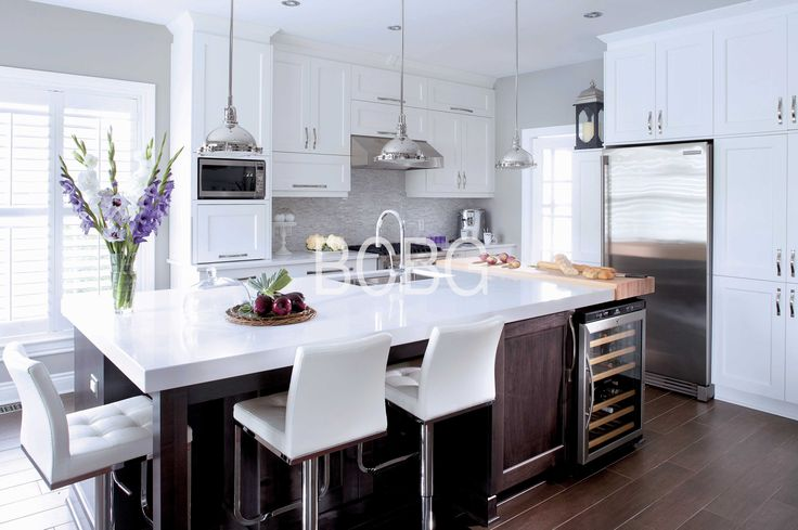 Contemporary kitchen style with maple cabinets painted in white lacquer.