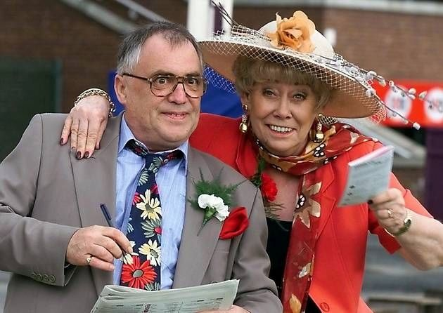 Coronation Street stars Bill Tarmey and Liz Dawn alias Jack and Vera Duckworth enjoy a day at the races along with other cast members Friday 2 July 1999. Description from eveningnews24.co.uk. I searched for this on bing.com/images