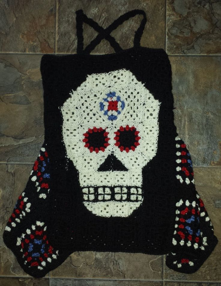 I made this Sugar Skull Granny Square top back in July and ...