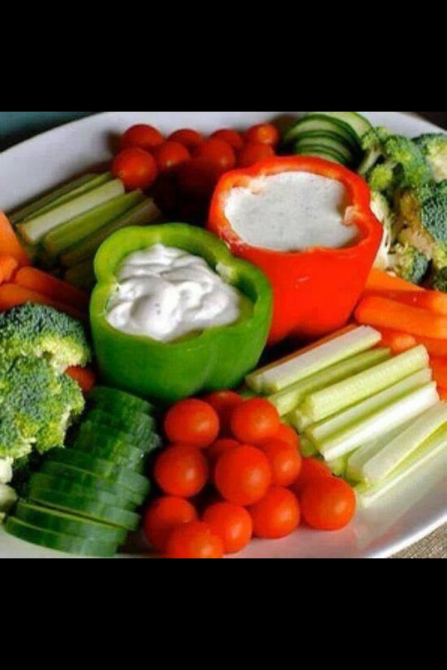 Veggie tray- hollow out peppers to hold veggie dip! Genius