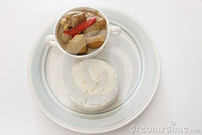 Famous asian dish Chicken Kurma served with white rice white isolated background
