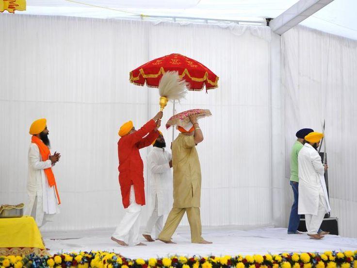 A 'sevakaar' takes the Guru Granth Sahib, Sikhism's holy book, on his head from the Chowki to sukhaasan after prayers, in Gurgaon. (Abhinav Saha/HT Photo)