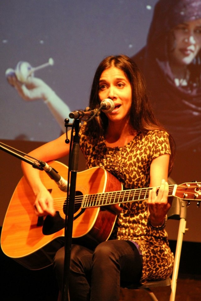 Hispano-Saharawi singer and guitarist Suilma Aali, by Julia Ridlington