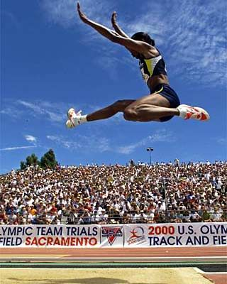 Spectacular. Olympic champion Jackie Joyner-Kersee soars past spectators during the long jump at the 2000 U.S. trials.