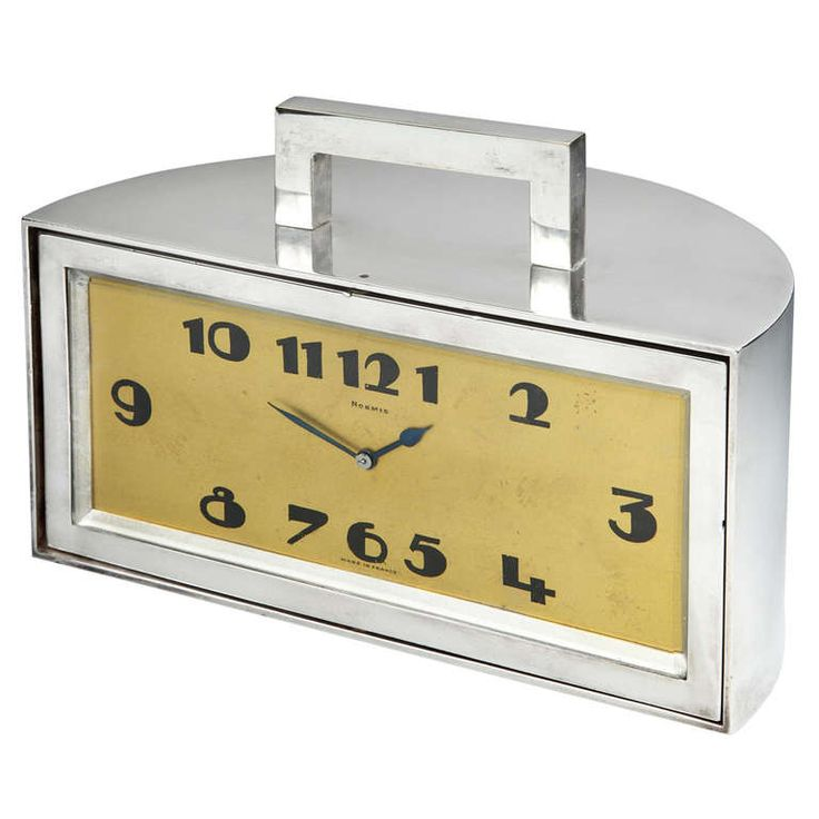 A fabulous and unusual Art Deco demilune mantel or desk clock, the heavy nickeled bronze mechanical movement clock with angular top handle, with wide, stylized Art Deco clock face and numerals, rotating to reveal a hidden wood lined trinket or cigarette box behind.