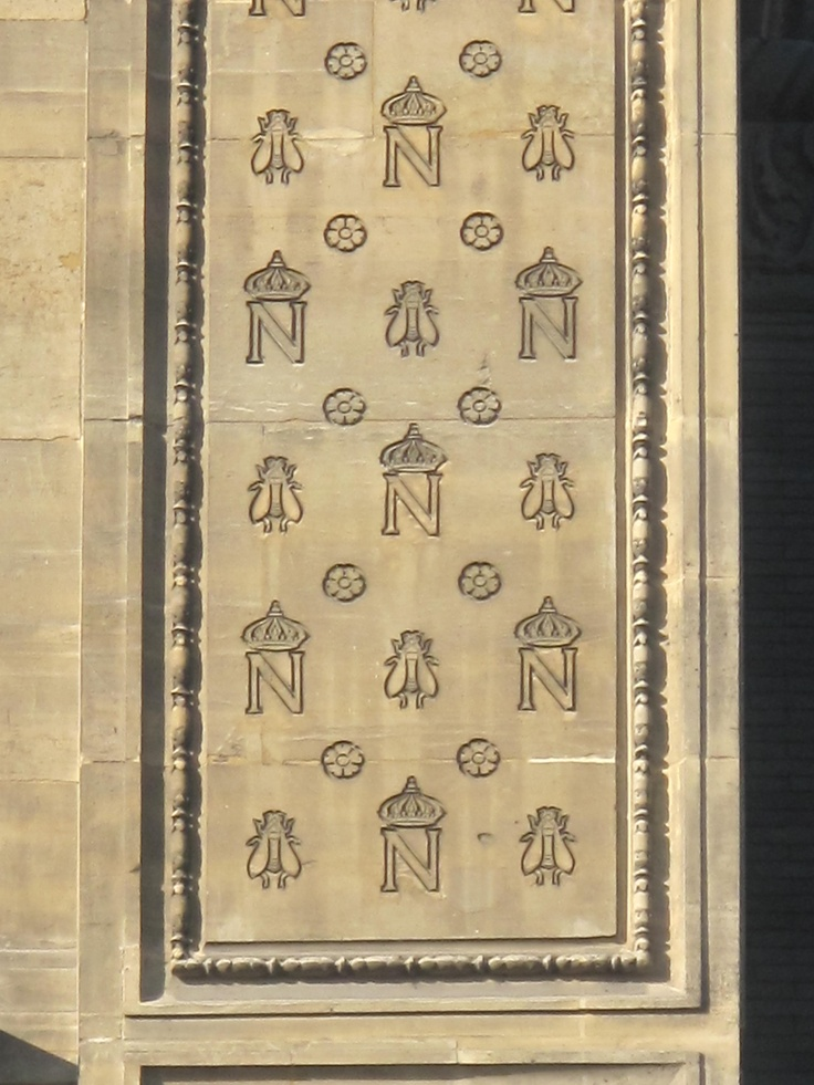 Monogram of Napoleon 1st with bees at the 3rd floor of the pavillon Richelieu of the Louvre, on the rue de Rivoli, Paris, France. The bee was a symbol of the French Empire.