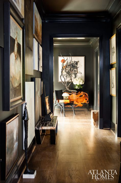 Black hallway peppered with framed art // Design by Michel Boyd, SmithBoyd Interiors // Photographed by Erica George Dines | Atlanta Homes & Lifestyles