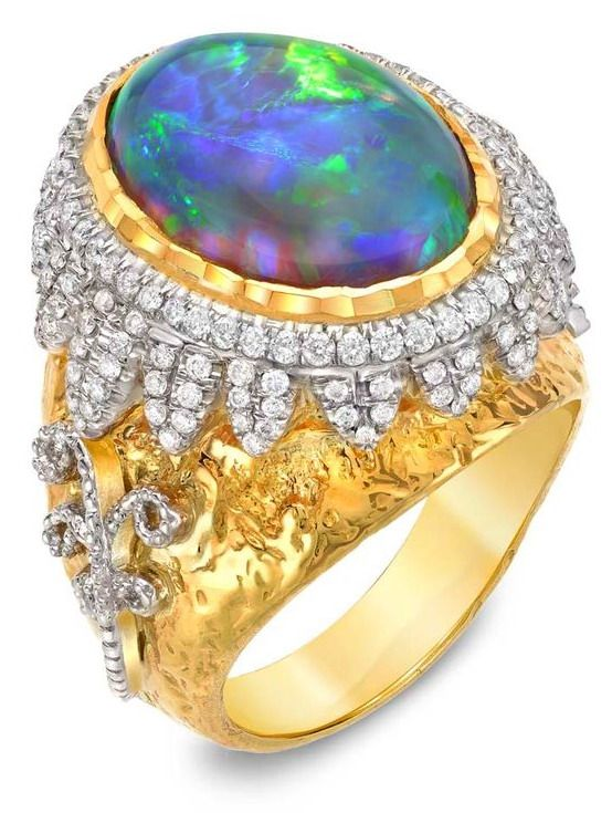Victor Velyan yellow and white gold ring with a central black opal and diamonds.