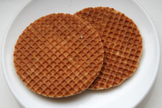 This is a Dutch favorite, though Ive seen them recently at Starbucks (horribly overpriced, of course). If you dont have a pizzelle iron, dont despair. Theres a super-easy shortcut: just buy waffle cookies at your supermarket (and Trader Joes has some really fantastic cookies for sure). Thats what I ended up doing, so dont think I am a whiz at pizzelle making!   I halved this recipe, and was still able to have filling leftover when I made 12 cookies. I think this recipe is for filling full…