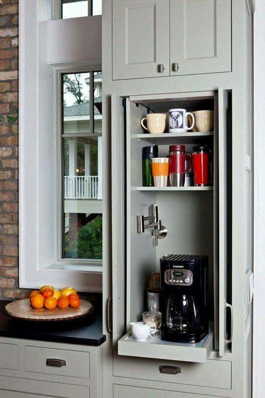 A larger cupboard to store all mugs, tea/coffee/hot choc, coffee machine... maybe kettle, too?