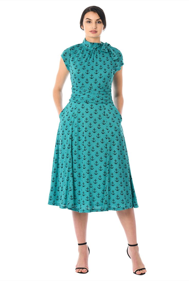 Our anchor print cotton knit dress gives you a flattering look in a fit-and-flare cut with soft ruching nipping in the wide waist and sweet ties at the high neck.