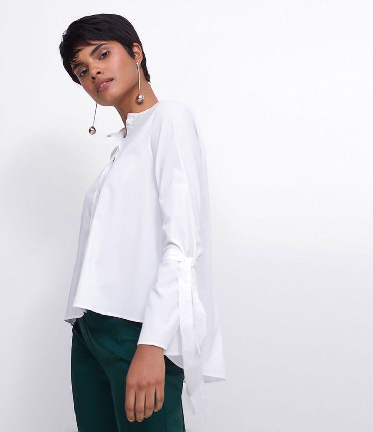 Camisa feminina  Manga longa  Com amarração  Marca: Cortelle  Tecido: Tricoline  Composição: 63% algodão, 33% poliamida e 04% elastano  Modelo veste tamanho: 36     Medidas da Modelo:     Altura: 1.76  Busto: 89  Cintura: 63  Quadril: 89     COLEÇÃO INVERNO 2017     Veja outras opções de    camisas femininas   .