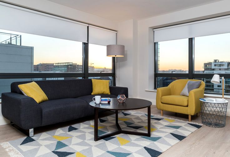 Residential - Fit Out - Apartment - Living Area - Yellow - Blue - Teal - DFS Sofa - Tubby Armchair - Geometric Rug - Solan Coffee Table - Millennium Tower, Dublin by Think Contemporary