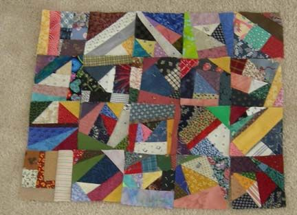 """Okay - glad I haven't thrown away all those tiny pieces of scraps yet.  Here's a tutorial for making these """"crumbs"""" into blocks!"""