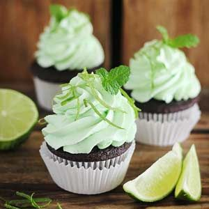 Rum, lime zest, and fresh mint infuse this cupcake frosting recipe will all the flavors of a mojito cocktail. Try it on top of homemade chocolate cupcakes for an adults-only dessert.
