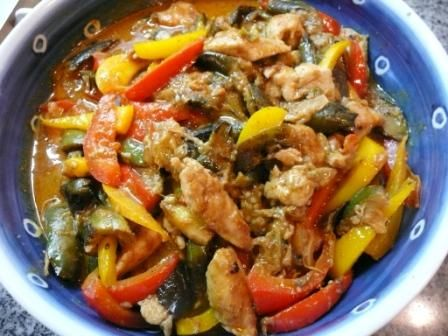 Thai red curry with eggplant and beef/chicken. Ingredients: Chinese or Japanese eggplant, beef or chicken, red bell pepper, garlic, ginger, coconut cream, red curry paste, chilli, fish sauce, lime juice, basil leaves. From savourasia.