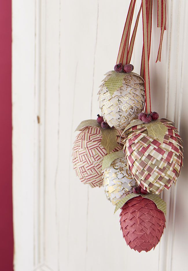 Decorate your home for winter with Zoë Patching's intricate Christmas paper pine cone decorations.