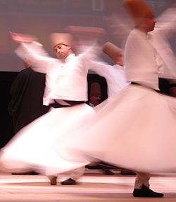Sufi whirling (or Sufi spinning) is a form of Sama or physically active meditation which originated among Sufis, and which is still practiced by the Sufi Dervishes of the Mevlevi order. It is a customary dance performed within the Sema, or worship ceremony, through which dervishes (also called semazens) aim to reach the source of all perfection, or kemal.