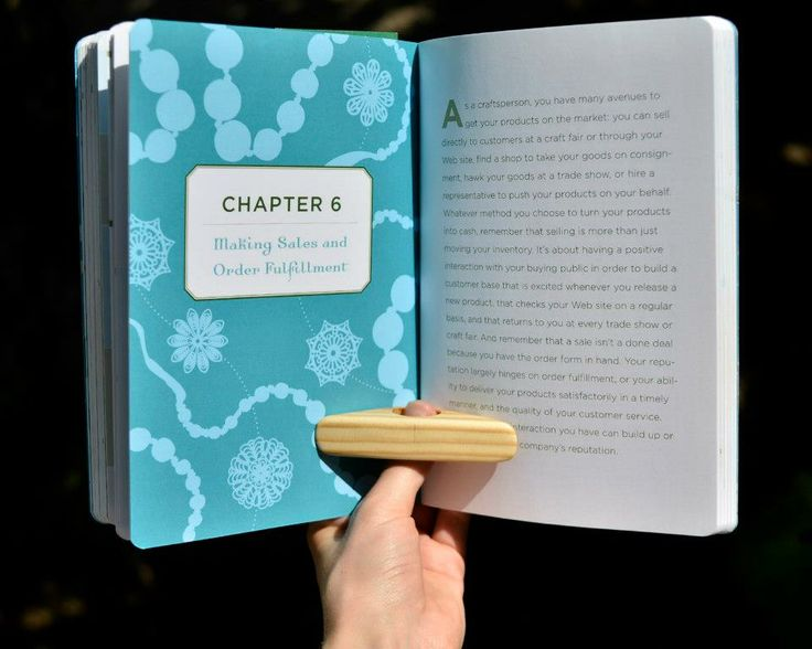 Awesome reading ring! Helps you keep the book while you read, looks great and it's made entirely of wood! Designed and produced by Woodish