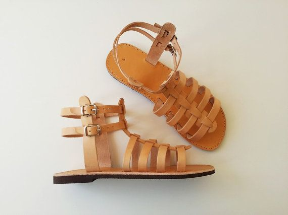 Greetings visitors,  Enjoy your summer vacations with this beautiful handmade ancient greek leather sandal made in Greece by Leatherhood. This flat