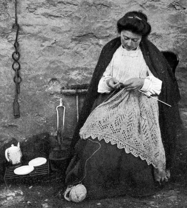Old ancestry visit genealogy Scottish family history photograph image of a crofter kinitting outside her cottage on Fair Isle, Scotland