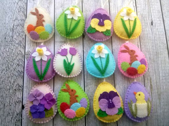 Felt easter decoration - felt eggs / set of 12 - bright spring colors  Listing is for 12 ornaments - 8 eggs with various flower designs - 3 eggs with bunny - 1 egg with chicken  If you would like different set please send me a message and we will work out options.  Handmade from wool blend felt Size of my decorated eggs is about 2 1/8 x 2 5/8 inch (5,3 x 6,5 cm) This is size of felt egg without hanging loop  This is made to order item