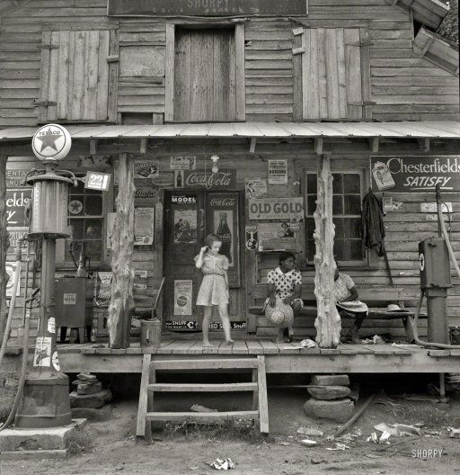 "July 1939. ""Daughter of white tobacco sharecropper at country store. Person County, North Carolina."" The rustic emporium seen earlier here and here. Medium-format nitrate negative by Dorothea Lange."
