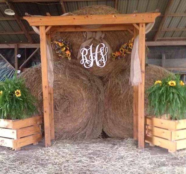 I like the hay in the back, maybe without the flowers with lights and toole wrapped around the frame