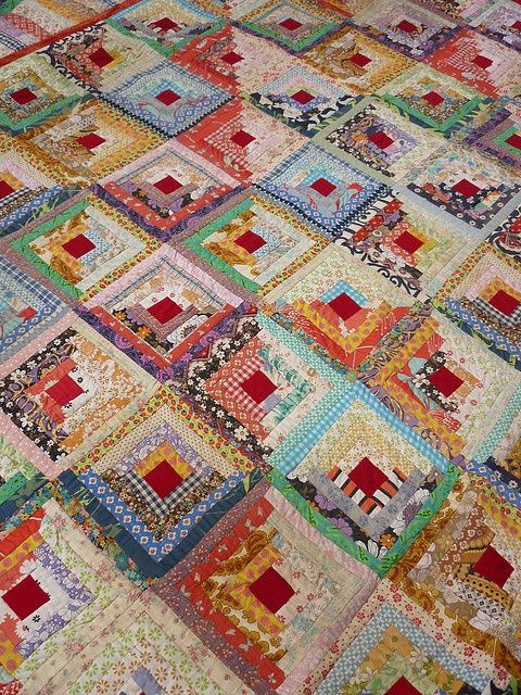 Scrappy Log Cabin - use your imagination with colors and patterns to create this beauty..