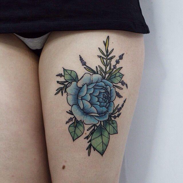 Blue rose thigh tattoo