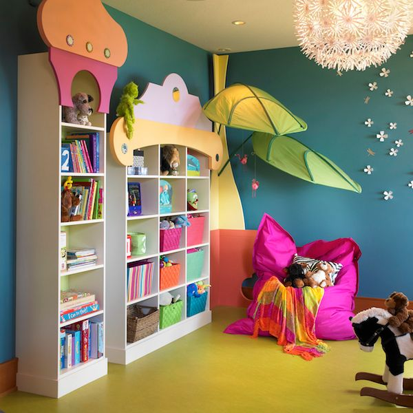 Colorful girl's #playroom with #Ikea #light fixture, #storage bins, and #wall decals.