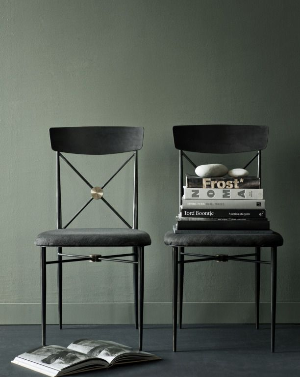 The Canvas/Jason Wu Dining Chair is made from welded steel chair with a hand-waxed finish, a midnight linen upholstered seat, and brass details; $1,290 each.