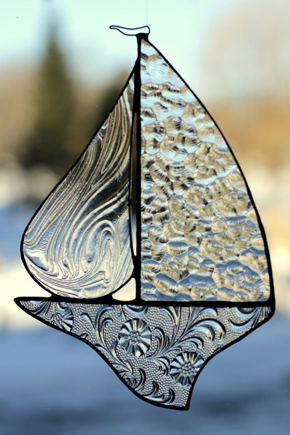 "Textured Clears - Stained Glass Sail Boat. $32.00, via Etsy. Visit etsy.com Stained Glass Sailboat... - Chiseled Floral Clear Hull - Swirled Texture Clear Jib - Heavy Hammered Clear Main Sail - Wire Directional Flag - Bronze Patina / Waxed Luster Finish - Mono-filament for hanging. H - 9 1/2"" / 24cm W - 6 1/2"" / 17cm"