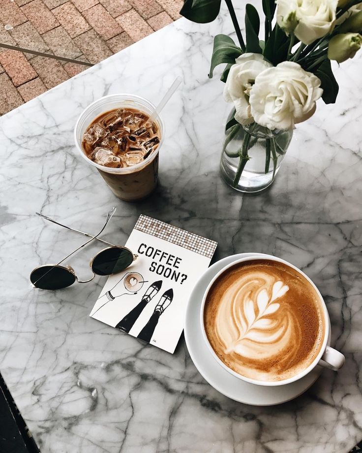 Cute Marble Table Top With Latte And Iced Coffee Atop Alongside Fresh Flowers And An Adorable Card