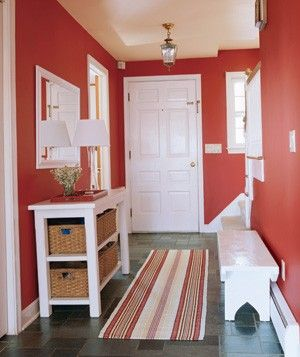Define your entryway with a bold color like this red, which exudes a warm welcome.