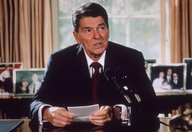 How Ronald Reagan Went from Movie Star to President: American president Ronald Reagan makes an announcement from his desk at the White House, c. 1985