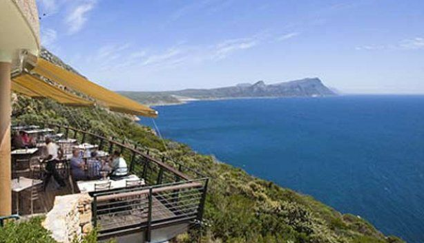 A simple wooden deck looks out onto one of the most stunning ocean views in South Africa. The Two Oceans Restaurant occupies an enviable position above False Bay at the southwestern tip of Africa