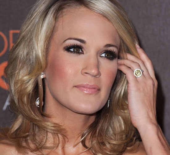 Carrie Underwood flashes her round yellow diamond. We love it!