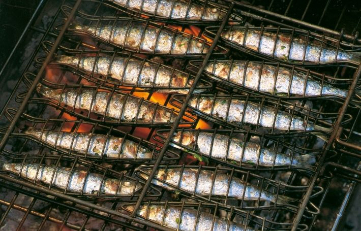 Sardines have a very evocative flavour and aroma that perfectly suit eating out of doors. This is a recipe that can easily be prepared well ahead of time and, if the coals on the barbecue are good and hot, the fish are cooked in moments. If sorrel is unavailable, use young spinach leaves mixed with some grated zest of lemon – about 1 tablespoon – for the stuffing. If it rains, the sardines will cook perfectly well under a domestic grill or on a ridged grill pan.