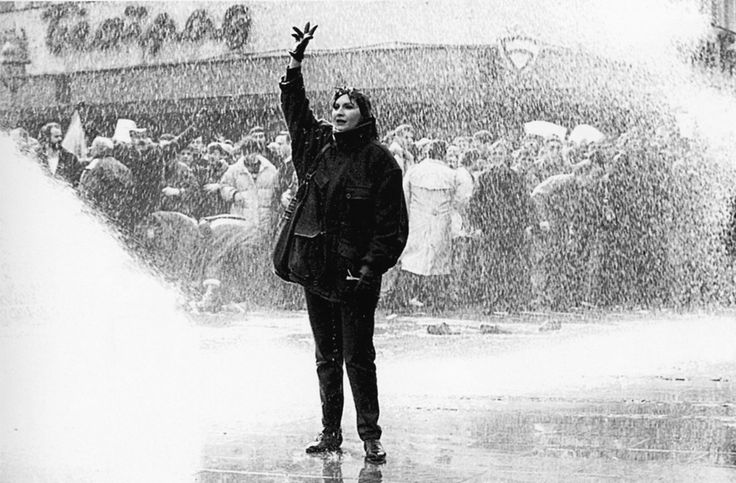 A participant of a protest against Milosevic being sprayed with water cannon, Serbia, March 9, 1991