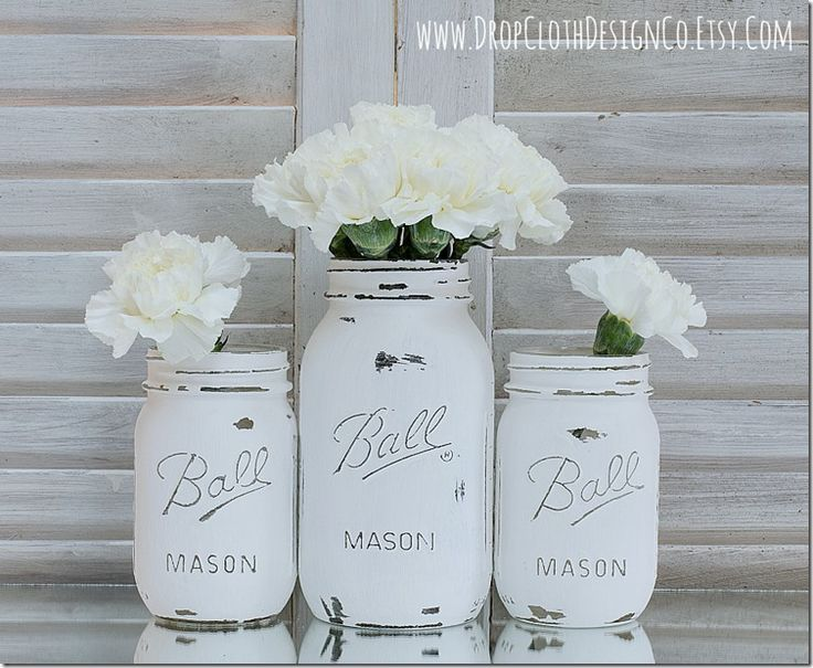 Painted and distressed mason jars in Annie Sloan Chalk Paint Pure White: