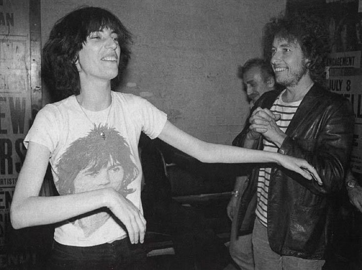 """When you stop being surprised and delighted by people, you might as well give up and crawl into your grave."" - Danny Fields. (Bob Dylan and Patti Smith (wearing Keith Richard's T-Shirt) - Backstage Bitter End 1975)"