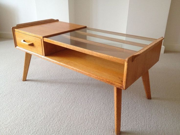 The coffee table was known as a cocktail table, with the glass top used for cocktails before a meal. The designer was Victor Bramwell Wilkins (V B Wilkins) – the table is one of G Plan's most iconic early, and now, exceptionally rare pieces. | eBay!