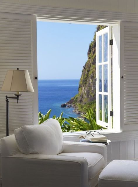 Inspiration for a cozy reading nook next to a window -- and view of the sea.