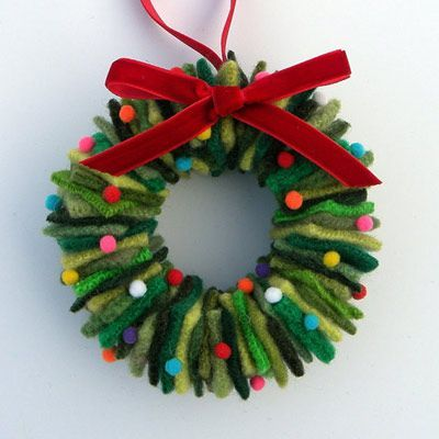 This adorable decorative wreath ornament is made using old wool sweaters cut into squares, threaded through a wire hanger and topped with a bow. Or you can buy them for under $8.00 from Alicia Todd at Etsy.com | thisoldhouse.com: